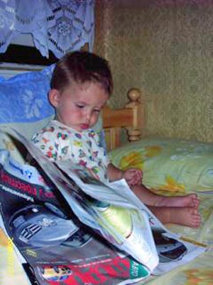 A photo of a toddler reading.