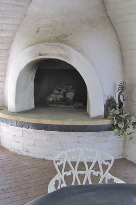 A photo of a cold fireplace.