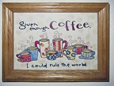 A photo of a cross-stich that says, 'Given enough coffee, I cold rule the world.'