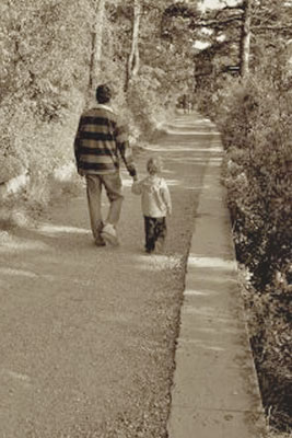 A photographic image of a father and child in autumn.