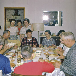 A photographic image of a holiday dinner at Herbert G. and Abbie Mae Neal's farm in 1968.