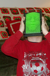 The last photo from our 2008 album where Aiden presses his face into his present.