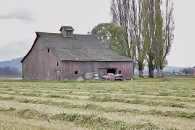 A photographic image of an old barn.