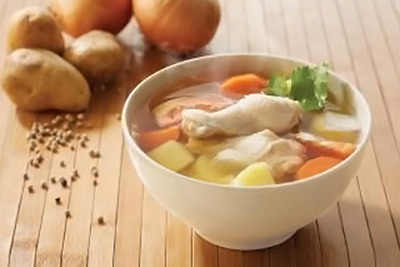 A photographic image of a bowl of Thai chicken soup.