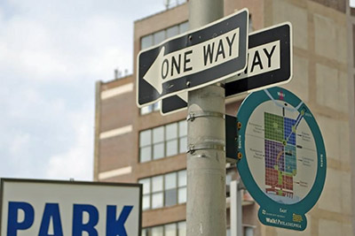 A photographic image of one-way street signs.